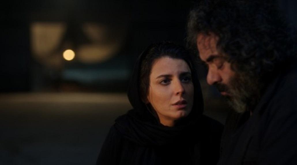 حسن معجونی در صحنه فیلم سینمایی خوک به همراه لیلا حاتمی