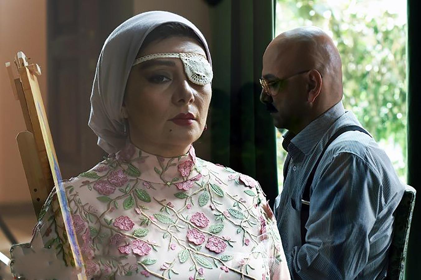 هنگامه قاضیانی در صحنه فیلم سینمایی یک قناری یک کلاغ به همراه حبیب رضایی